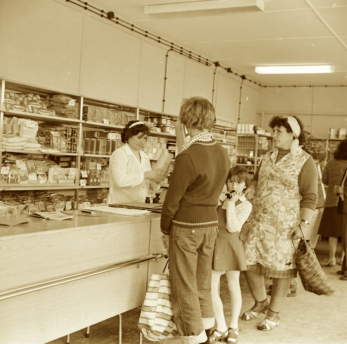 The inside of a shop in 1979. The shop assistant helps the queuing customers. Source: National Digital Archives